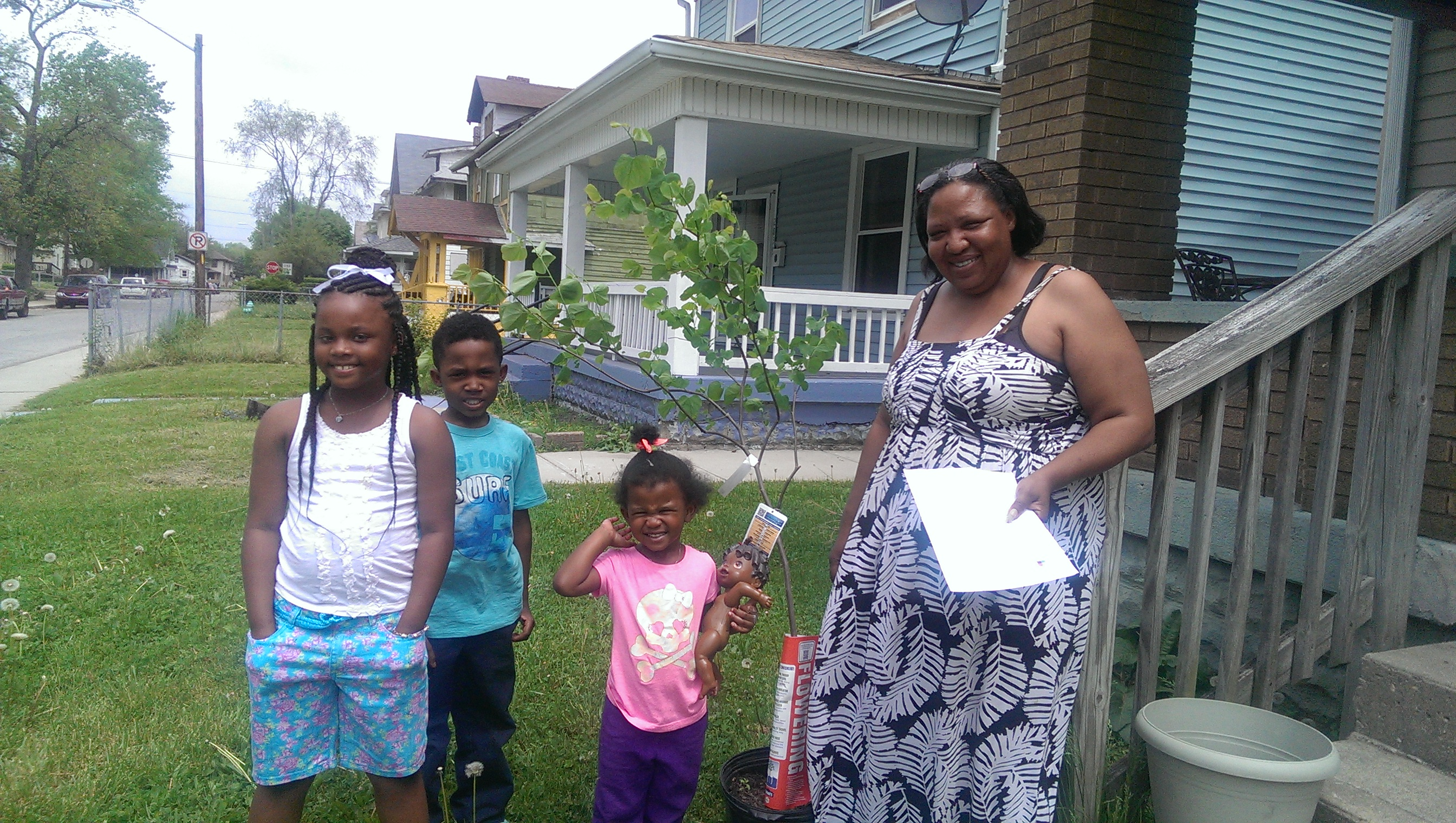 Residents and their new Redbud trees.