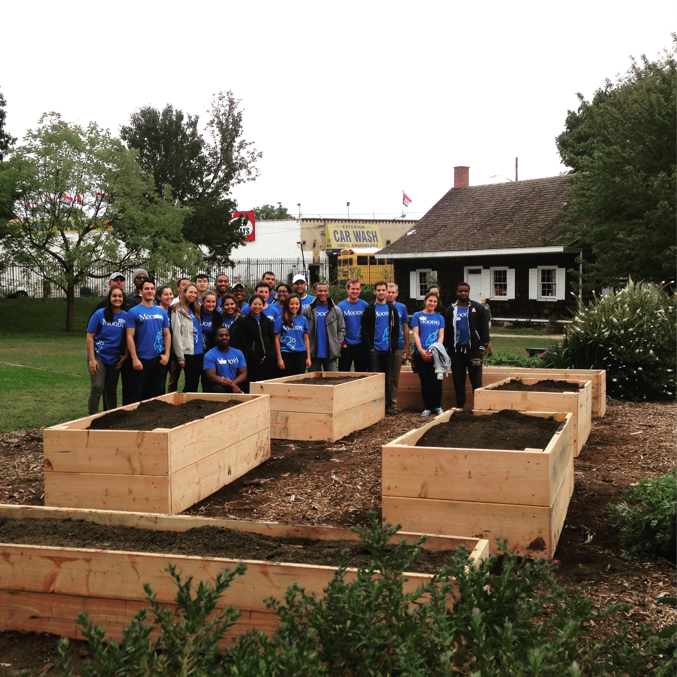 Building new raised garden beds with volunteers