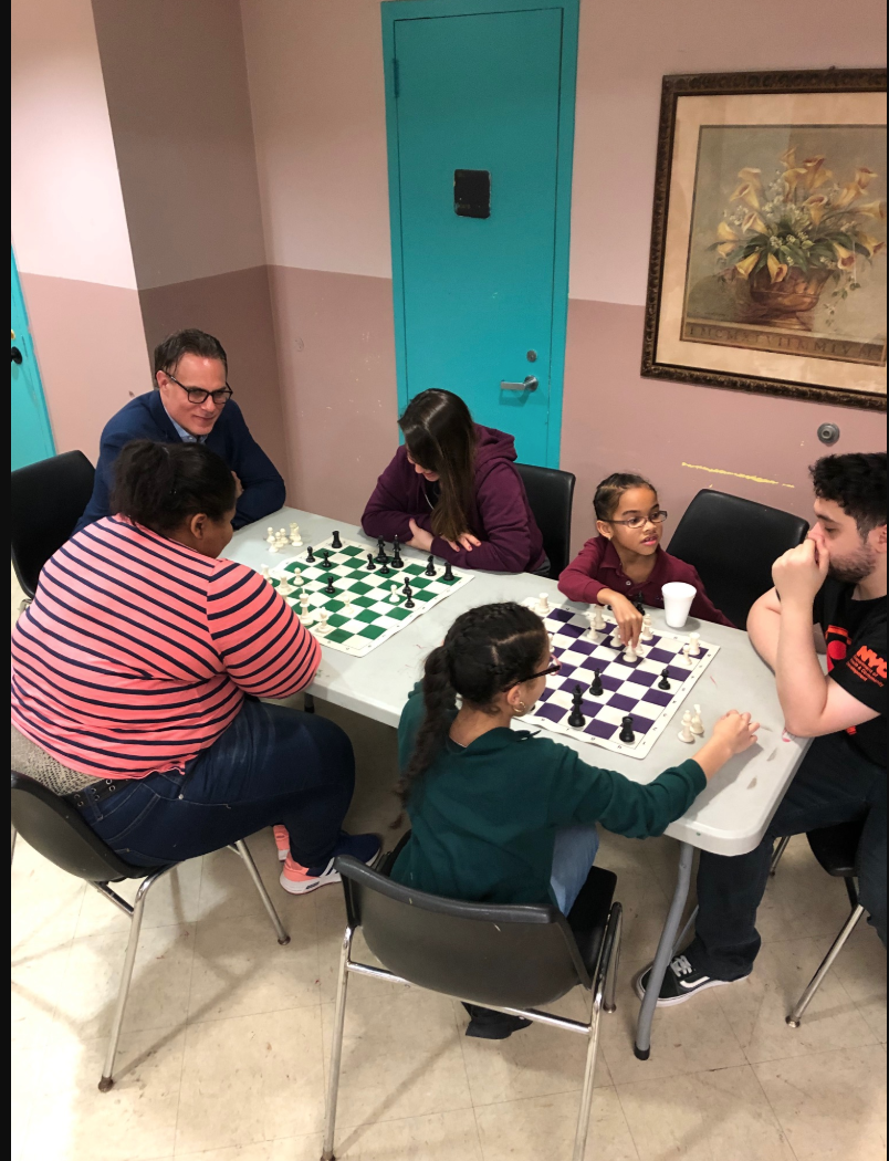 Students play each other at chess