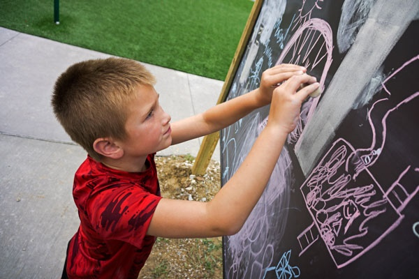 Child at Chalkboard