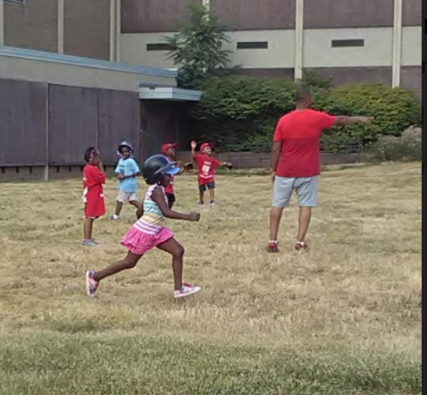 community kickball game with young imaginations