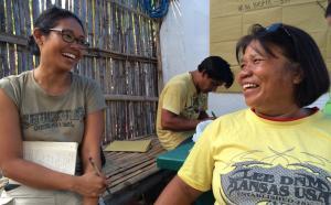 Empowering women post-Super Typhoon Haiyan: Two Filipina women exchange big smiles, Bantayan Island, Visayas, Philippines, 2015. Photo by Cecilia L