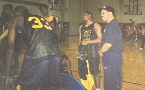 Coach Webbo in the huddle motivating his players