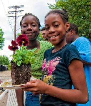 Kids plant flowers