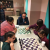 Chess-4-Kids instructor guides participants to make their best moves